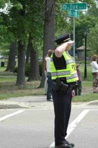 Bartlett Police salute the flag as it passes by