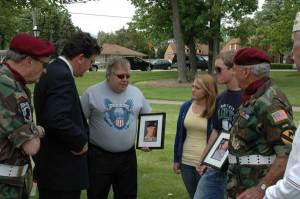 Village President Mike Kelly talks to residents about recent lost soldiers