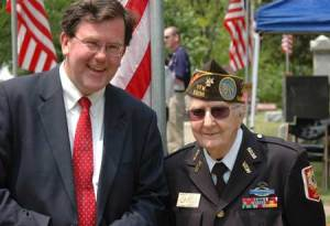 Village President Mike Kelly Stops for a photo with Veteran Walt Grajek