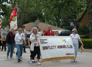 Bartlett Womens Club waives as they pass by